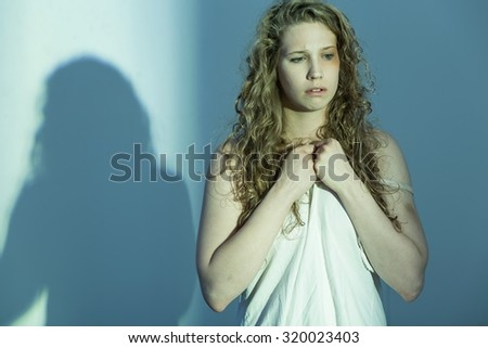 Picture of young woman in trauma thinking about suicide - stock photo