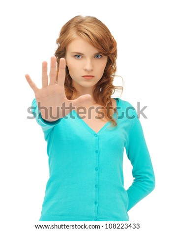 picture of young woman making stop gesture - stock photo