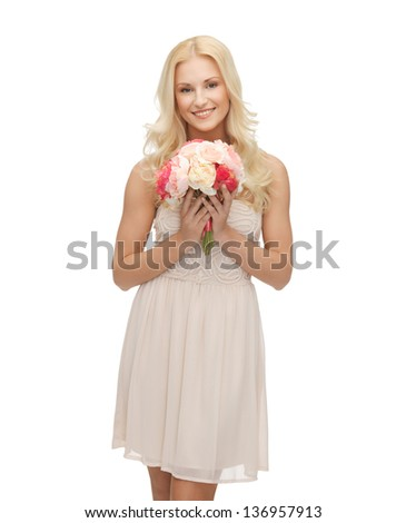 picture of young woman with bouquet of flowers. - stock photo