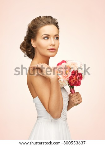 picture of young woman with bouquet of flowers - stock photo