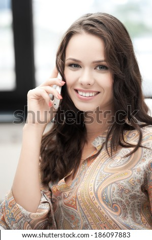 picture of young woman with mobile phone - stock photo
