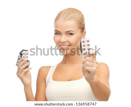 picture of young woman with variety of pills - stock photo