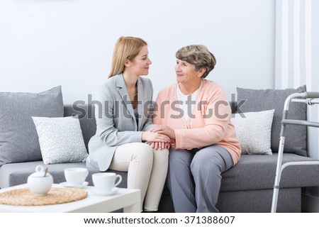 Picture presenting friendship between grandmother and granddaughter - stock photo