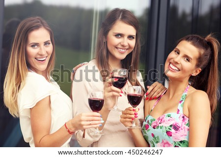 Picture presenting happy group of friends with red wine - stock photo