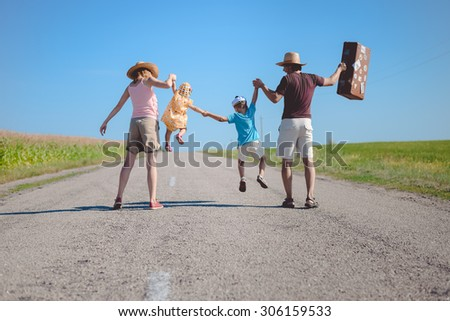 Picture silhouette of family joyful walking on the countryside rural road on sunny blue sky outdoors background - stock photo