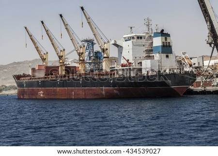 Picture with a old ship working on water - stock photo