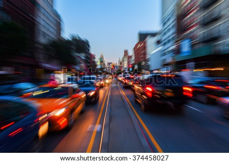 picture with creative zoom effect made by camaera of night traffic in the big city - stock photo