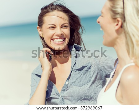Picture women on the beach - stock photo