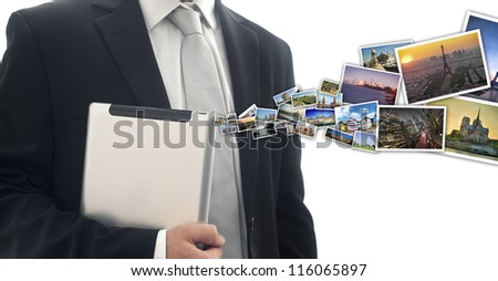 pictures moving out a businessmen's tablet - stock photo