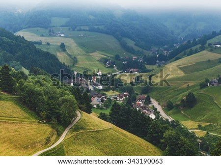 Picturesque aerial panorama with historic mountain village in Germany. Muenstertal, Black Forest. - stock photo