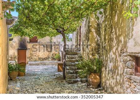 Picturesque alleyway in lower Monastery of St. John the Baptist.is part complex of the Patriarchal Preveli Monastery of St. John the Theologian, known as the Monastery of Preveli.Crete.Greece.Europe. - stock photo