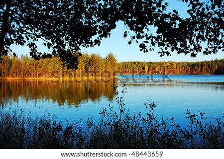 Picturesque autumn scenery on a lake in Finland - stock photo