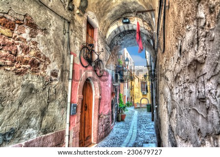 Picturesque backstreet in Bosa, Italy. Heavy processed for hdr tone mapping effect. - stock photo