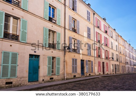 Picturesque cobbled street in Paris, France - stock photo