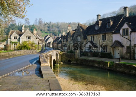Picturesque Cotswold village of Castle Combe, England - stock photo