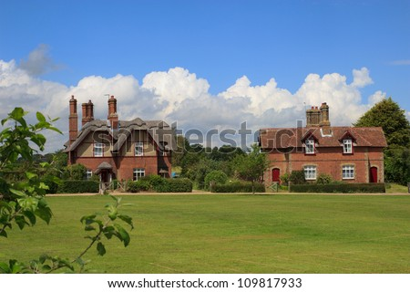 Picturesque cottages (some thatched), surround the village green at Somerleyton, Suffok, England. - stock photo