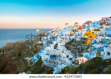 Picturesque famous view, Old Town of Oia or Ia on the island Santorini, white houses and windmills at sunset, Greece - stock photo