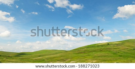 picturesque hills against the blue sky - stock photo