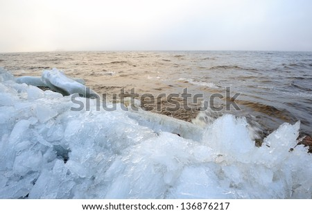 Picturesque landscape of the Baltic sea with ice boulders - stock photo