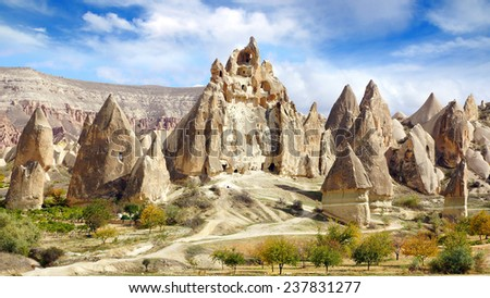 Picturesque landscape with Fairy chimneys, Cappadocia in Turkey. - stock photo