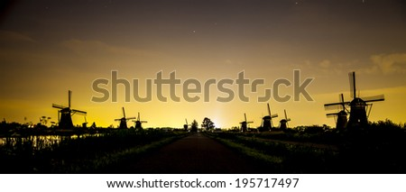 Picturesque landscape with windmills - stock photo