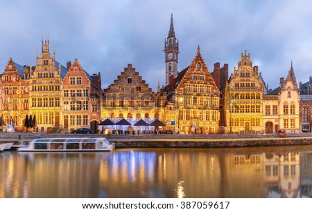 Picturesque medieval building on the quay Graslei in Leie river at Ghent town at evening, Belgium - stock photo