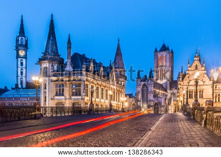 Picturesque medieval buildings around Korenmarkt square ( Saint Nicholas' Church, The Celtic Towers,... ) overlooking the Leie river in Ghent town, Belgium, Europe. - stock photo
