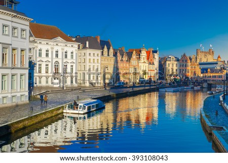 Picturesque medieval buildings on quay Korenlei and  quay Graslei,  Leie river in the morning, blue hour, Ghent, Belgium - stock photo