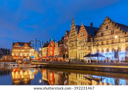 Picturesque medieval buildings on the quay Graslei in Leie river at Ghent town  in the evening, Belgium - stock photo