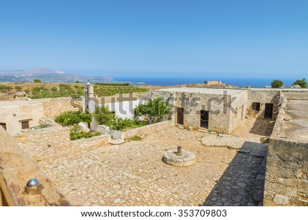 Picturesque old Monastery of Saint John Theologian in Ancient Aptera town at Crete island.The panoramic view from the height on the buildings,ruins and fortress on the Mediterranean sea Greece.Europe. - stock photo