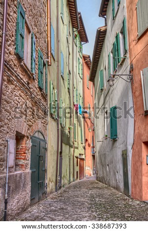 picturesque old narrow alley with colored walls in the ancient town Brisighella, Emilia Romagna, Italy - stock photo