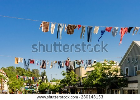 picturesque old timers clotheslines hanging in the middle of the street in the pioneer town of Columbia for the annual Country Fair celebration, California, USA - stock photo