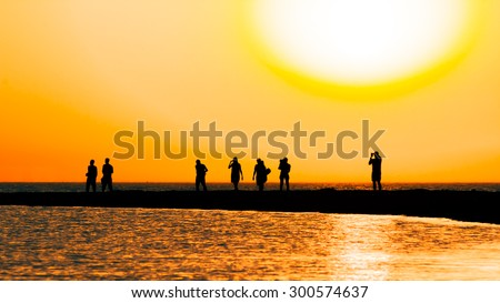 Picturesque orange sunset over  the sea on the summer evening. Selective focus - stock photo
