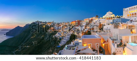 Picturesque panorama of Fira, main town of the island Santorini, sea, white houses and church at sunset, Greece - stock photo