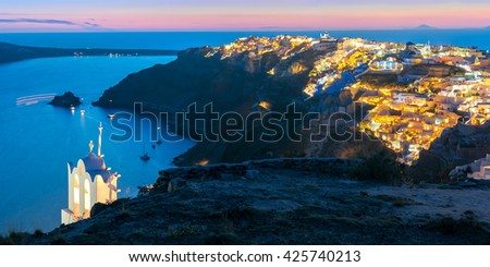Picturesque panorama, Old Town of Oia or Ia on the island Santorini, white houses, windmills and church with blue domes at sunset, Greece - stock photo