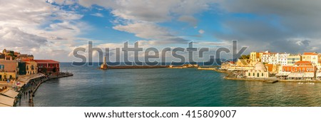 Picturesque panoramic view of old harbour of Chania with Lighthouse and Kucuk Hasan Pasha Mosque, Crete, Greece - stock photo