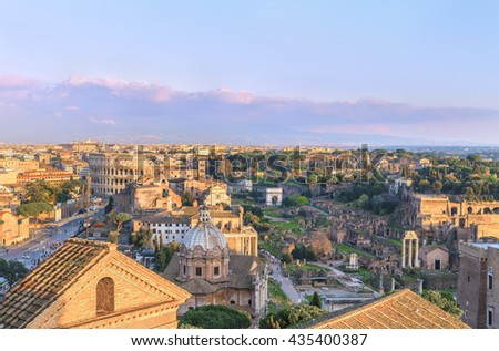 Picturesque Roman Forum, Palatine and Great Colosseum ( Coliseum, Colosseo, Flavian Amphitheatre ) in the evening,at sunset time. Aerial panoramic view on famous touristic landmark. Rome.Italy.Europe. - stock photo