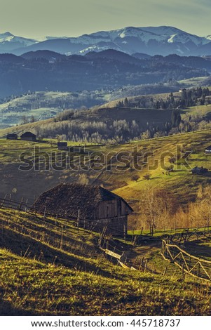 Picturesque rural landscape with traditional Romanian wooden house and country road uphill in Sirnea village, Brasov county, Romania. Travel destinations. - stock photo