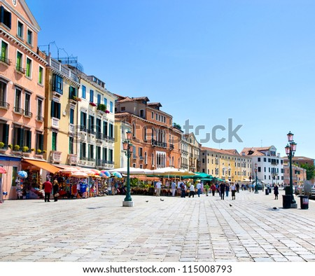picturesque seafront with street lamp in Venice, Italy in summer sunny day - stock photo