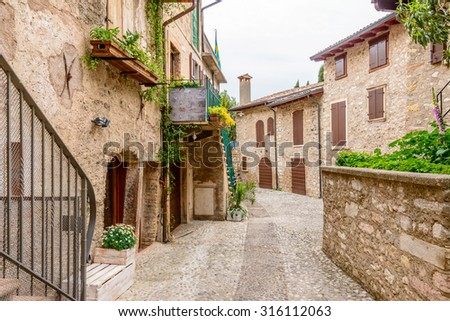 Picturesque small town street view in Limone, Lake Garda Italy. - stock photo