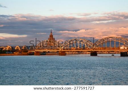 Picturesque sunset over the Railway Bridge in Riga, Latvia - stock photo