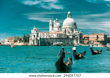 Picturesque view of Gondolas on Canal Grande with Basilica di Santa Maria della Salute in the background, Venice, Italy. Toning in cool tones - stock photo