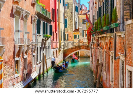 Picturesque view of Gondolas on lateral narrow Canal, Venice, Italy.  - stock photo