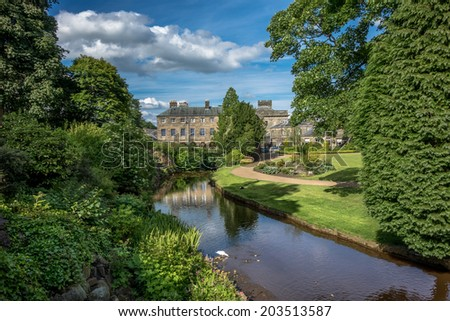 Picturesque view of typical stone buildings in Buxton from the park gardens. - stock photo