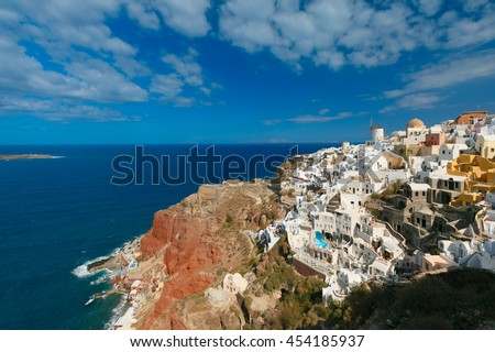 Picturesque view of windmills and white houses in Oia or Ia on the island Santorini, Greece - stock photo