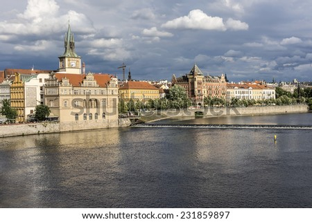 Picturesque views of the Old Town with its ancient architecture and banks of Vltava River at sunset, Prague, Czech Republic. - stock photo