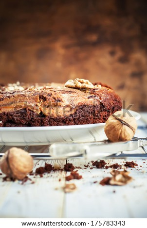 Pie from Chocolate, Cottage cheese and Walnuts on Wooden Background - stock photo
