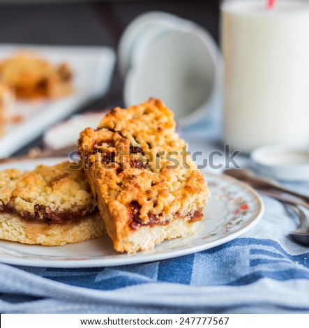 Pie in the short pastry with orange jam and milk,sweet pastries - stock photo