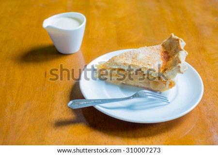 Piece of apple pie on a plate. - stock photo