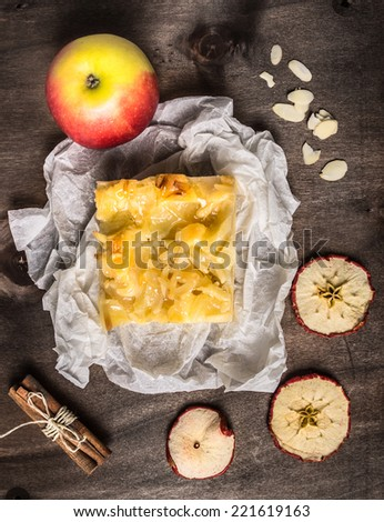 Piece of apple pie with almonds and cinnamon  - stock photo